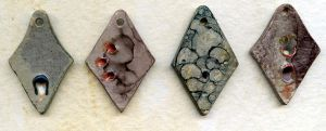 clawed ceramic pendants by Osa-Art-Farm
