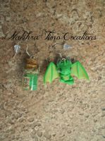 Baby dragon earrings by Nakihra
