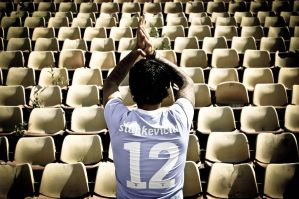Lonely Player in Empty Stadium 2 by KristeLynx