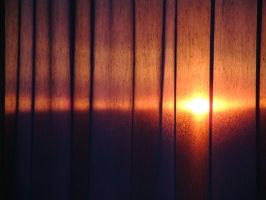sunset behind curtains by Titareco