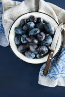Fresh plums (prunes) in bowl by BeKaphoto