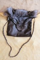 Crystal fox and leather pouch by lupagreenwolf