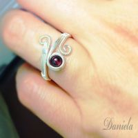 Silver ring with garnet stone by Assemblagestudio