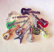 Polymer clay guitar necklaces by XxSierraRose