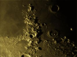 Caucasus Mountains and Cassini Crater by phrostie