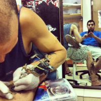 me tattooing a friend by royshtoyer