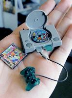 Miniature Playstation by veridisquotwo