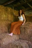 Solo Girl Roll in Hay 2 by candhphotography