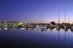 Sunset on the harbor by Coyotee1