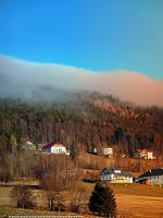 Clouds over the mountains by patrickjobst
