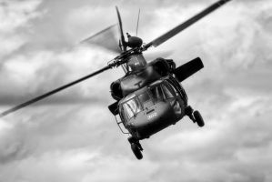 Blackhawk Under Stormy Sky by aviationbuff