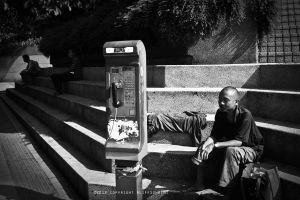 men with phone by AlipSuhaimi