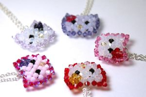 Circle of Hello Kitty Necklaces by kokito85