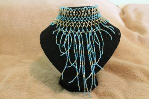 Light blue dancing necklace by SuperferretIX