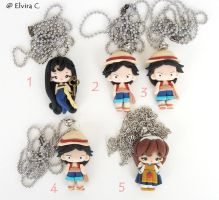Anime necklaces (Cat's eye, One Piece, Yakko) by elvira-creations