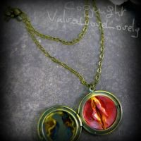 A French Flame: Yonic Vulva Locket by VulvaLoveLovely