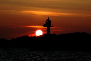 Lighthouse Sunset by grugster