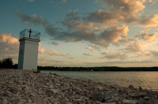 Lighthouse sunset by tbensic