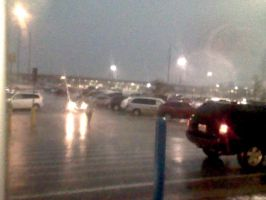 Damp parking lot at night by fattonysalerno