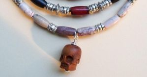Carved wooden skull and stone choker by artefaccio