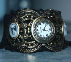 Steampunk kitties watches by Pinkabsinthe