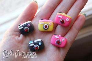 mini cameras by theredprincess