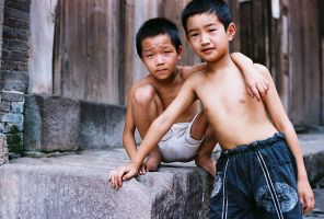 Two kids enjoying the hot by avotius