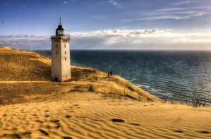 Lighthouse in the dunes by MartinJP