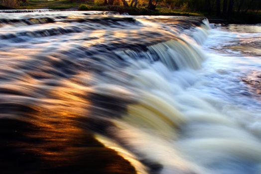 Sunset reflection on waterfall by RomGams