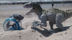 Indominus Rexy at the beach with a Gyrosphere by TechGnaw