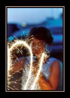 Girl With Sparkler by RavenPhotography