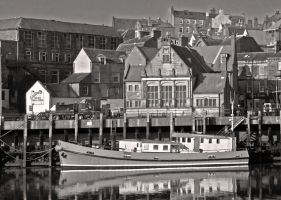 Red Boat in Whitby Harbour by Rebacan
