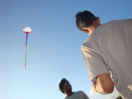 Friends flying kite by aaron4evr