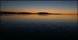Sunrise over placid waters by fl8us