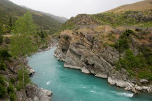 NZ River lef clear right blur, blue river by Chunga-Stock