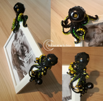 1# picture frame - black/yellow colored octopus by Wesenwaechter
