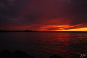 Burning sky over Reykjavik II by Cadhlan