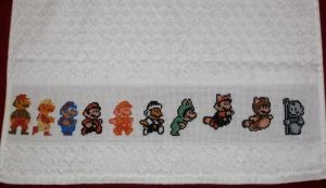 Mario Across the Ages by GamingBitCrossStitch