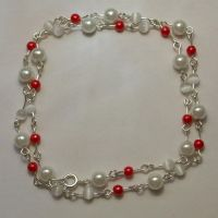 Red and white pearl necklace by bad-ass