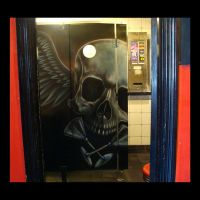 Airbrush skull in a toilet by kshandor