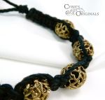 Gold bead and black cord macrame bracelet by cybelemoon