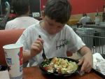 Tanner eating his first McDonald's salad by FillyBlue