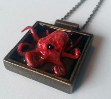 Red Octopus Resin Metal Pendant by spaceraptor
