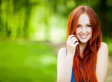 Red-haired smiley sun by Aleksie
