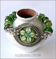 Green flower wire wrapped bracelet by Faeriedivine