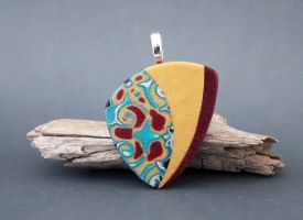 Swirly . Polymer clay pendant by earthexpressions