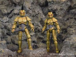 Male and female 3D printed androids with helmets by hauke3000