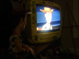 Woody watching Toy Story 2 by spidyphan2