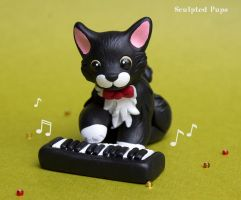 Tuxedo cat playing music sculpture by SculptedPups
