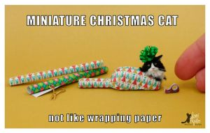 Wrapped tight cat sculpture by Pajutee